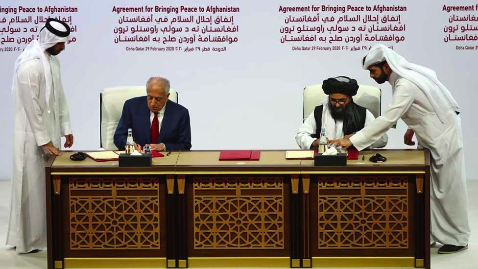 US and Taliban representatives sign an agrement