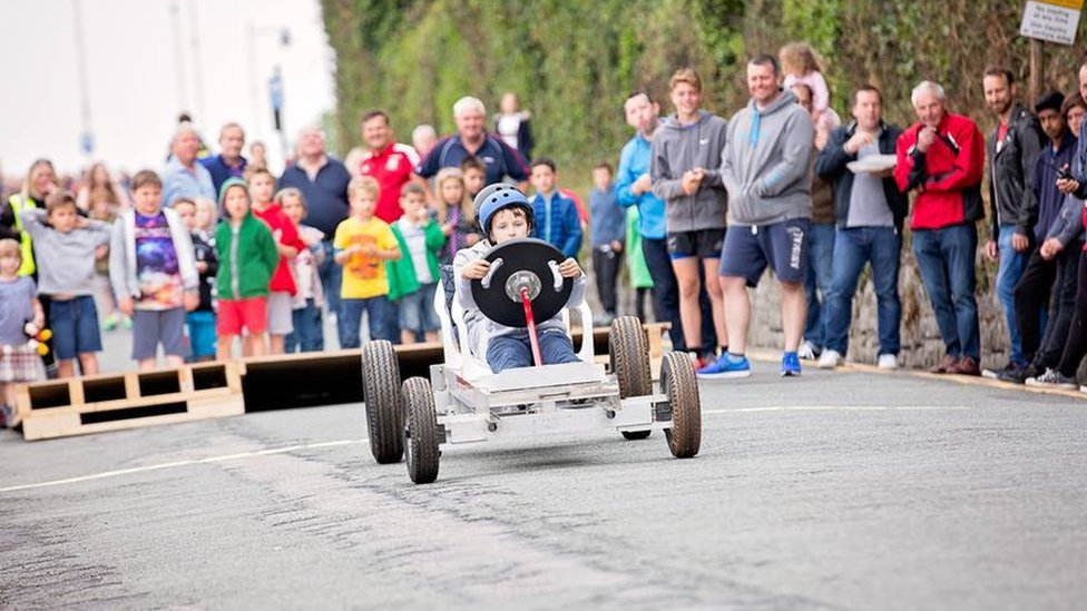 A soapbox makes its way down the course