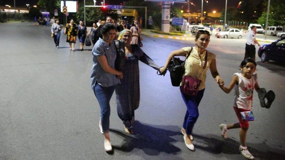 People walk away from Istanbul Ataturk airport