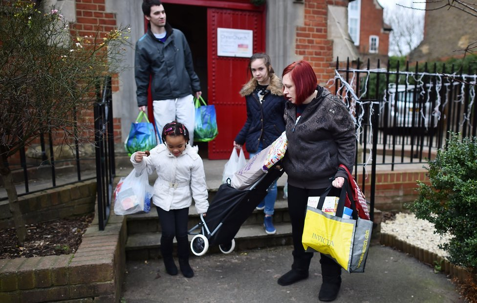 young family leave food bank