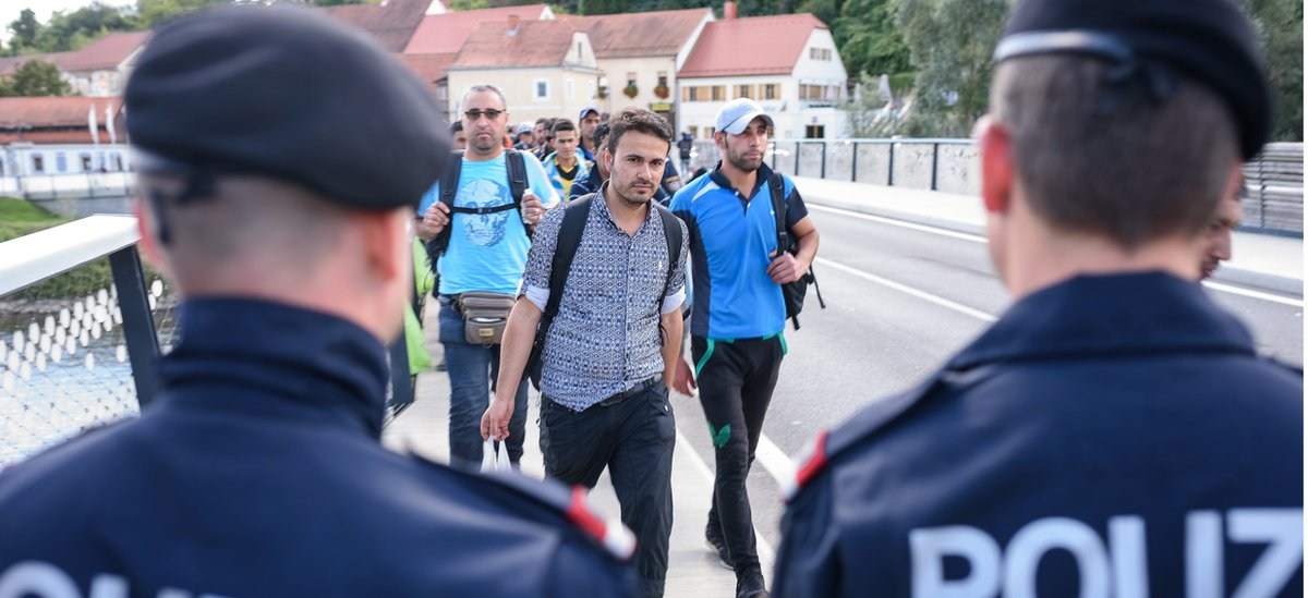 Migrants enter to Austria, from the Slovenian border city of Gornja Radgona, on September 21, 2015.