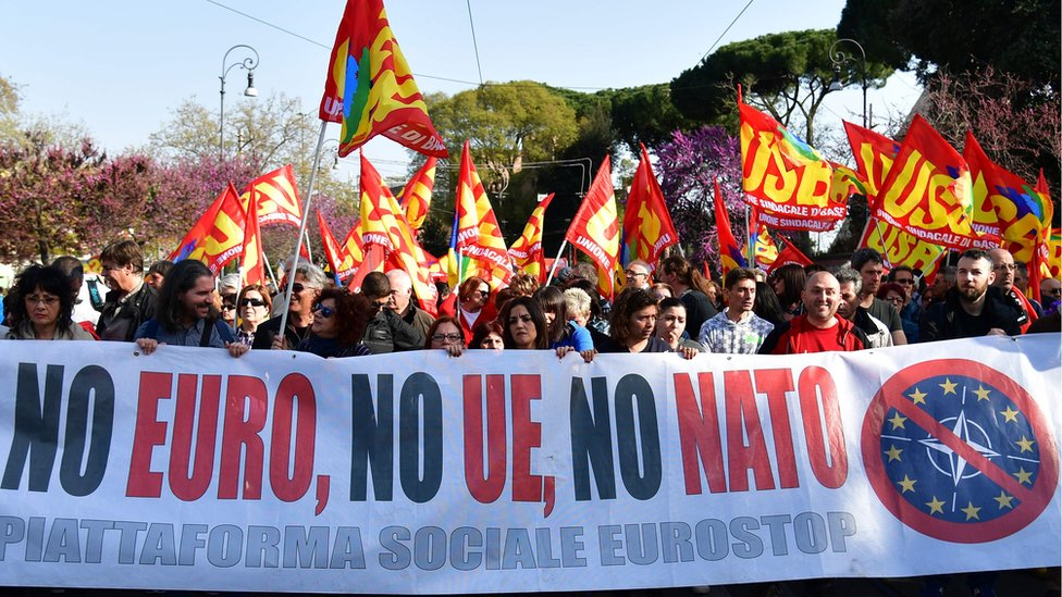 """People take part in a demonstration against the European Union (Euro Stop) on March 25, 2017 in Rome. Italian capital hosts a special summit of European leaders today to mark the 60th anniversary of the bloc""""s founding treaties"""