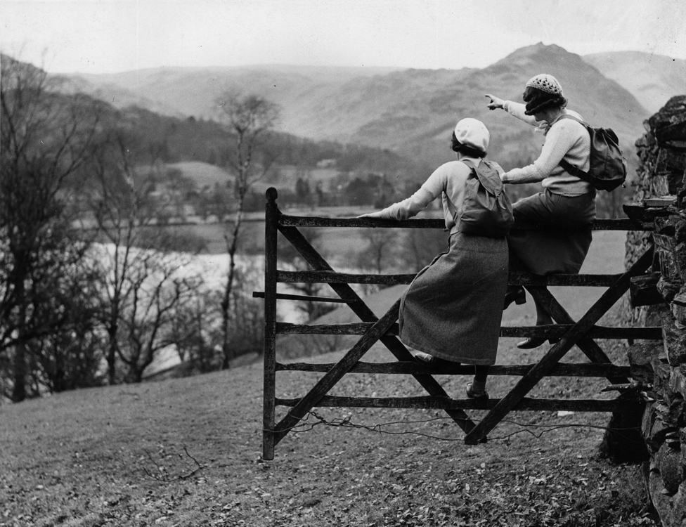 13th April 1935: Hikers viewing the scenery from the famous Wishing Gate at Grasmere in the Lake District.