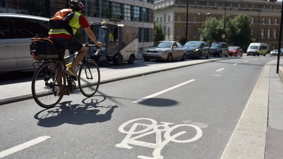 Man on cycle path in London