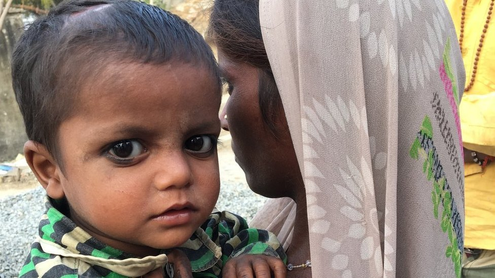 The fight over the Indian baby born in a bank queue