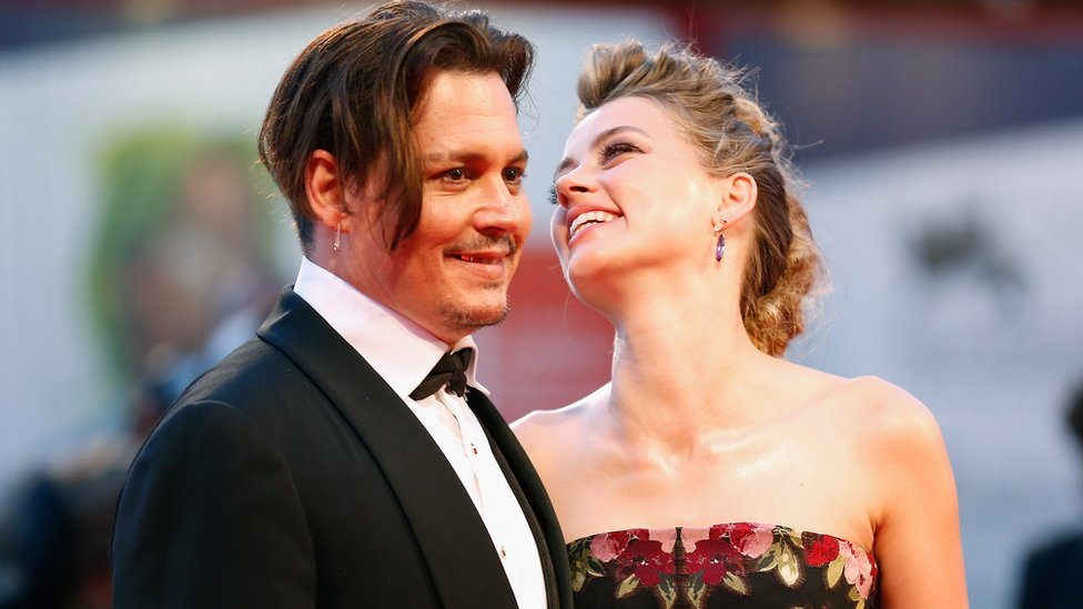 Johnny Depp and actress Amber Heard attend a premiere for 'The Danish Girl' during the 72nd Venice Film Festival at on September 5, 2015 in Venice, Italy.