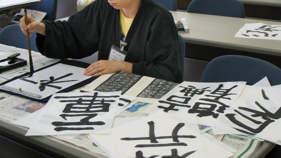 French trainee Marion Cossin learns the art of Chinese calligraphy
