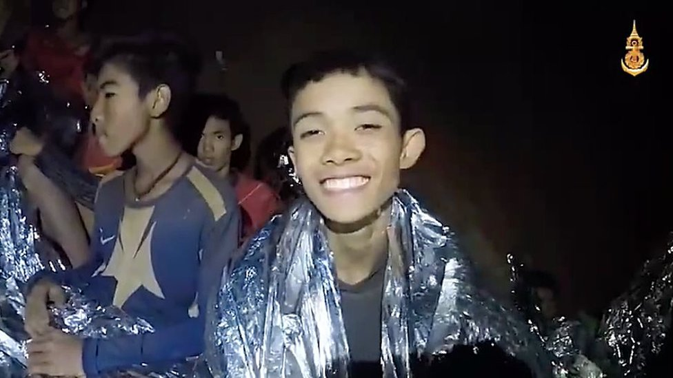 A video grab handout made available by Thai Royal Navy shows some of the members of a trapped soccer team in a section of Tham Luang cave in Khun Nam Nang Non Forest Park on July 04, 2018 in Chiang Rai, Thailand.