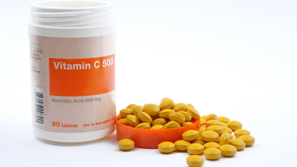 Vitamin C bottle with pills