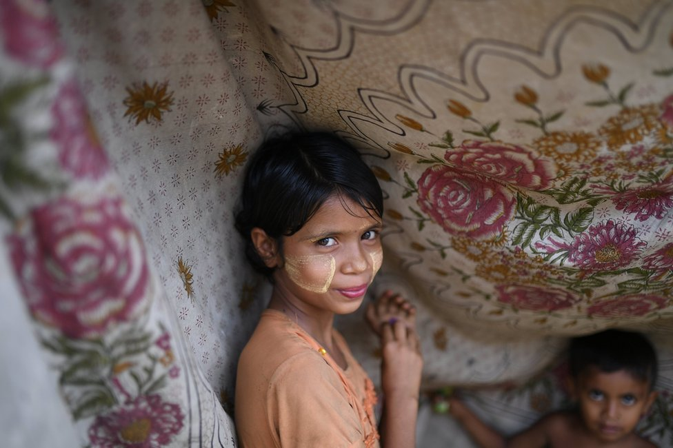 Rohingya refugee girl poses for a photograph as she wears thanaka paste at Shamlapur camp in Cox's Bazaar, Bangladesh
