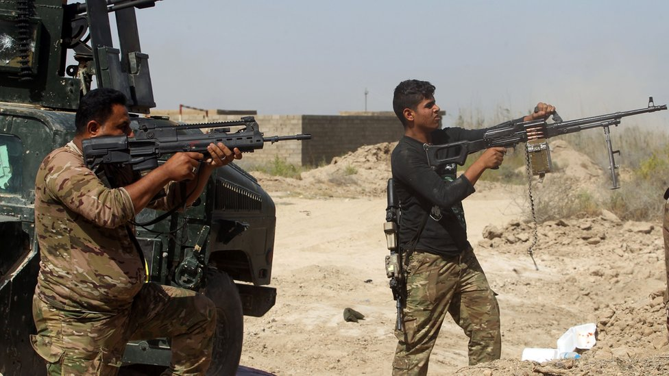 Member of Iraqi government forces in Fallujah's southern Shuhada neighbourhood on 15 June 2016