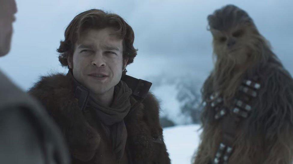 Alden Ehrenreich as Han Solo, with Chewbacca