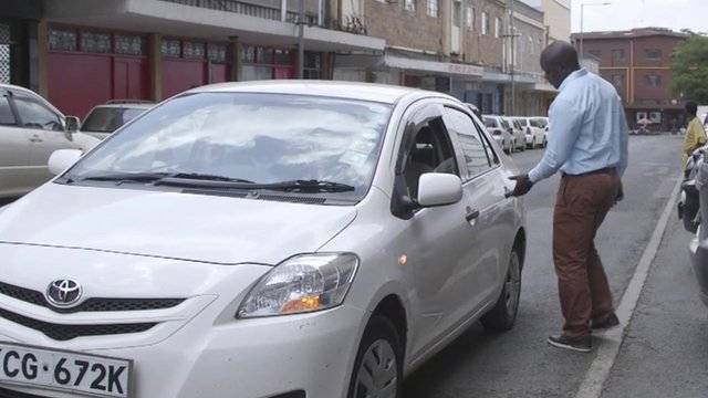 Man getting into taxi