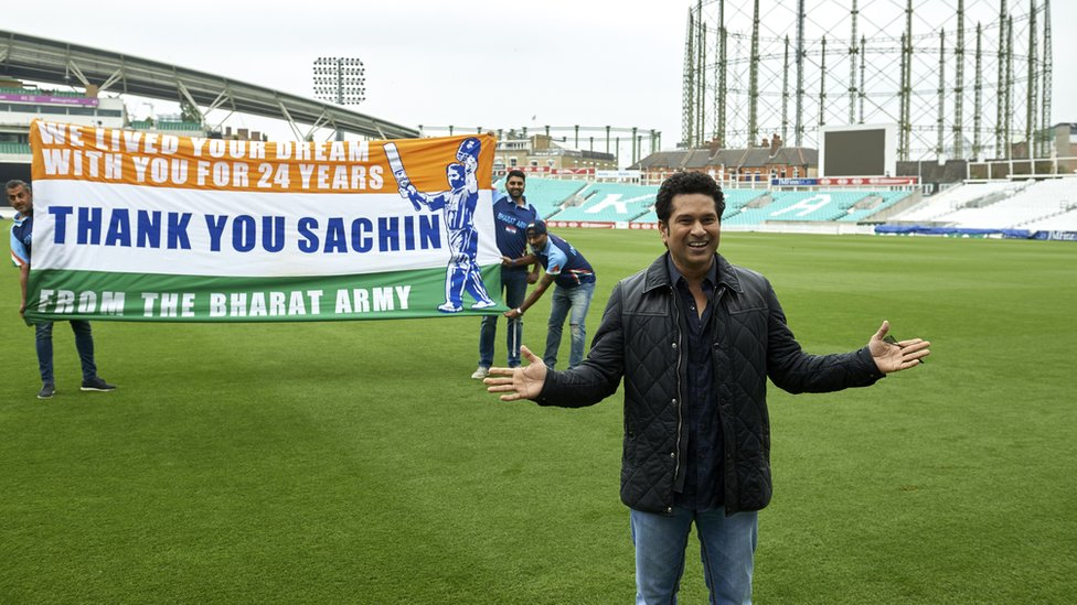 Indian cricket legend Sachin Teldulkar (R) poses for a photograph with members of the Bharat Army (Indian cricket fans), during a photocall at the Oval cricket ground in south London on May 6, 2017, promoting the upcoming release of his film, 'Sachin: A Billion Dreams'.