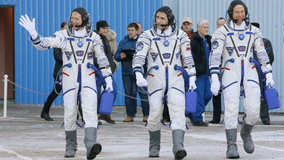 Tim Peake, Russian cosmonaut Yuri Malenchenko and US astronaut Tim Kopra prior the launch of Soyuz TMA-19M space ship at the Baikonur cosmodrome, Kazakhstan