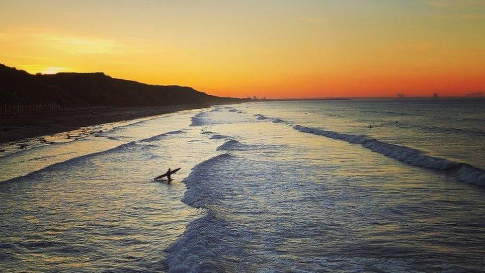 Surfer enters the sea