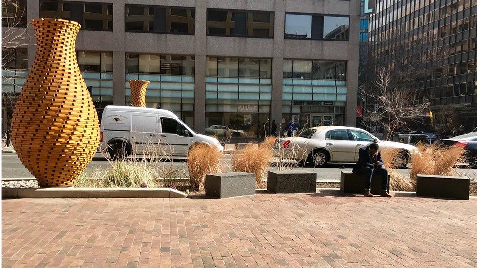 Concrete benches next to public art