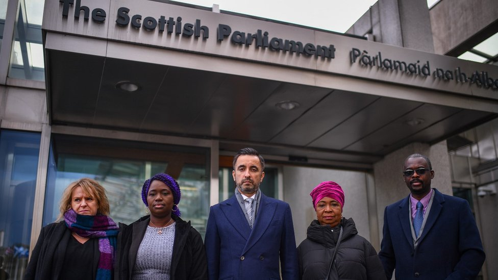 Debrah Cole, the director of Inquest, and lawyer Aamer Anwar with the Bayoh family outside the Scottish Parliament
