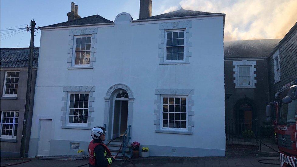 Devon house blaze after curtains catch fire