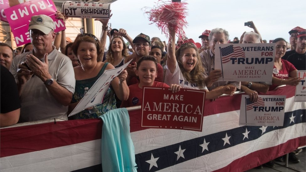 Supporters cheer US President Donald Trump during a rally at the Orlando Melbourne International Airport on 18 February, 2017 in Melbourne, Florida.