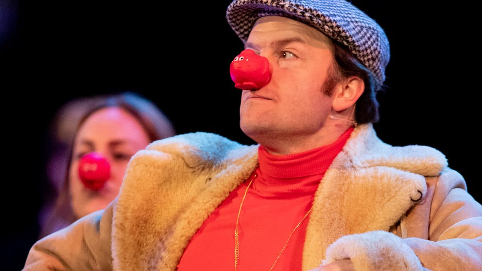 The stars of the Only Fools and Horses stage show wearing red noses in 2019