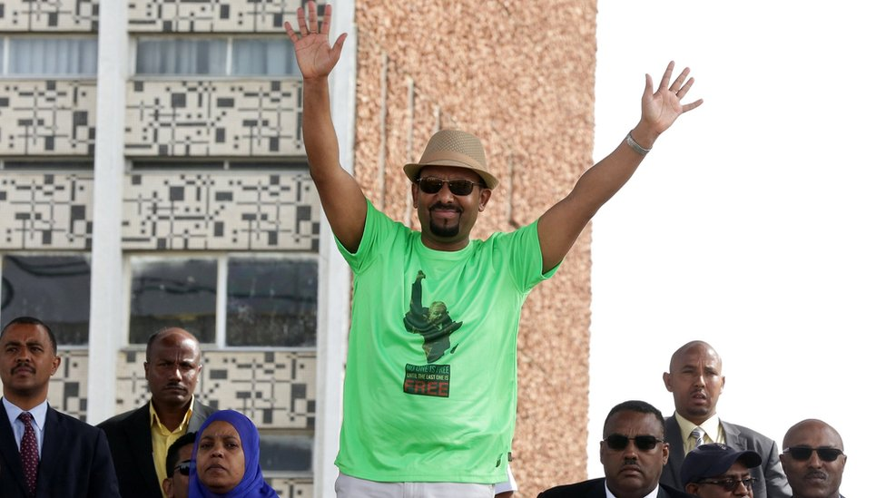 Mr Abiy waves during his speech
