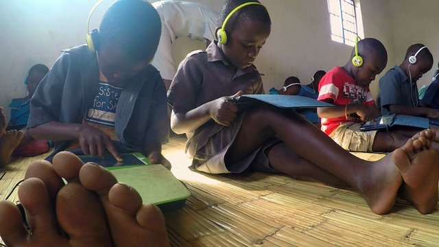 School children in Malawi using educational apps on tablets
