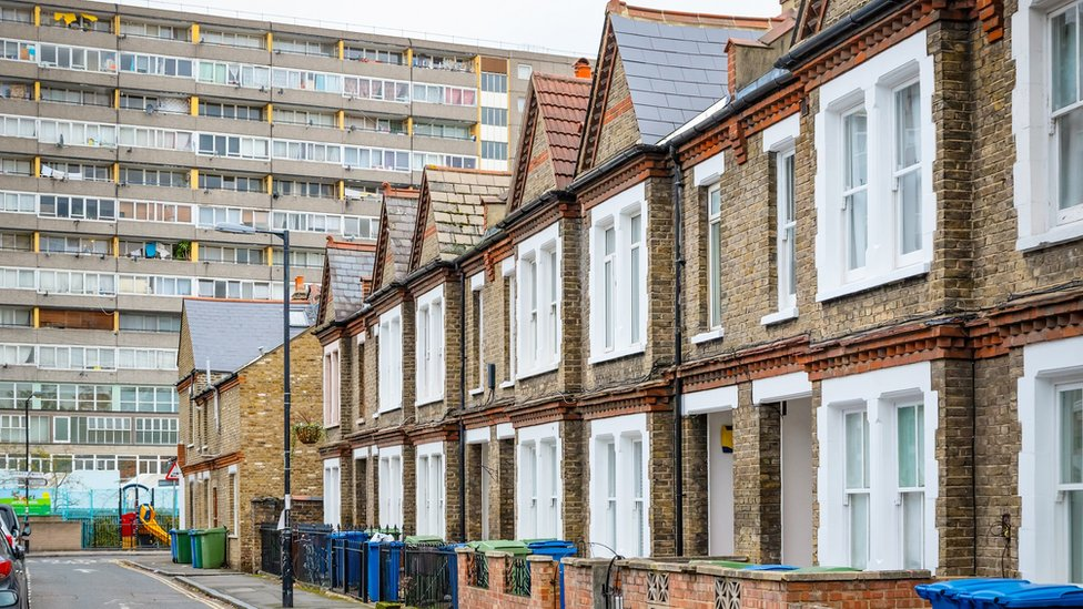 Houses with council block in background in south east London