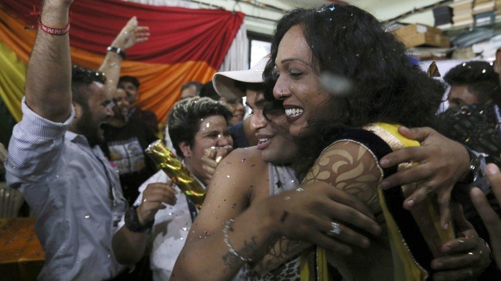 Activists celebrate in Mumbai