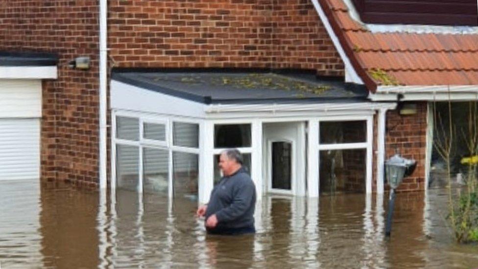 Steve McCarthy waist-deep in water