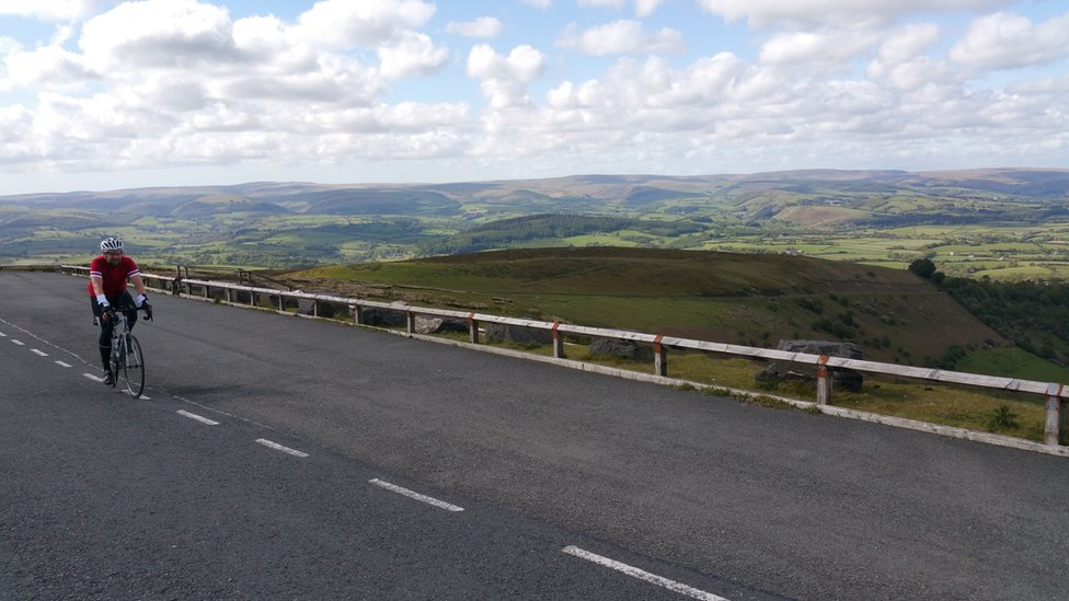 Will Smale cycling in the Wales' Cambrian mountains