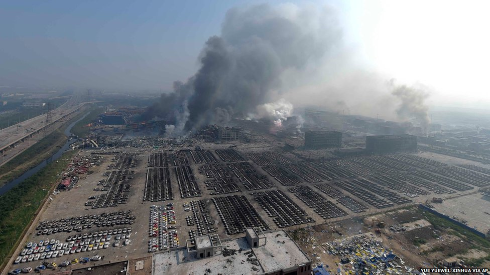 """In this photo released by China""""s Xinhua News Agency, smoke rise from the site of explosions from a nearby building in the Binhai New Area in northeastern China""""s Tianjin municipality, Thursday, Aug. 13, 2015."""