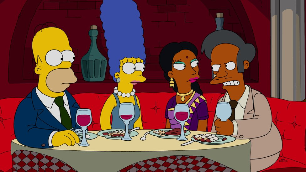 The Simpsons characters, from left to right: Homer and Marge, and Manjula and Apu