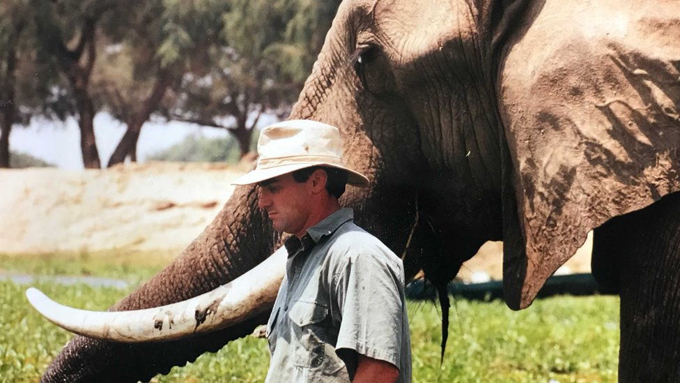 Nick Murray with an elephant when he was younger