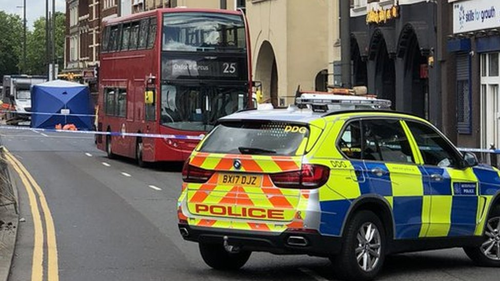 Woman dies after being hit by bus in east London
