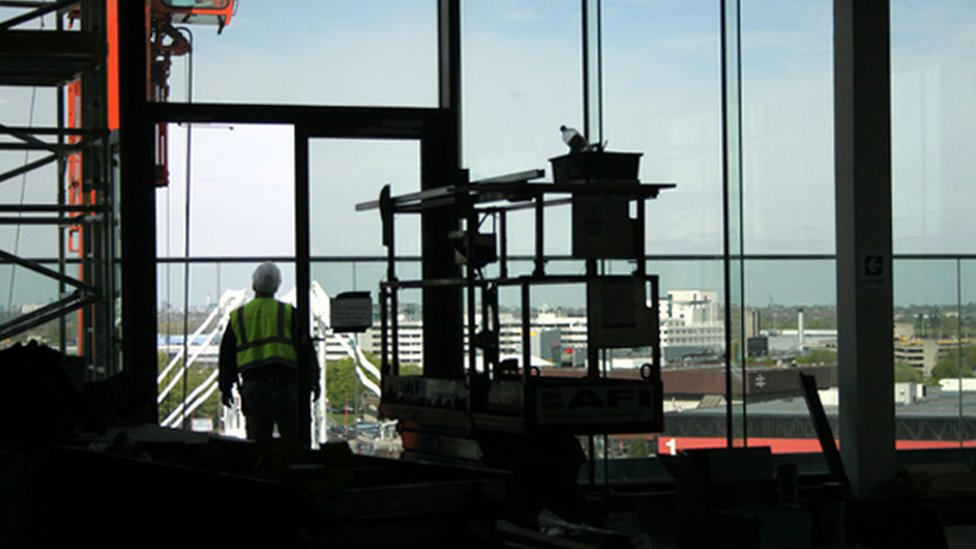 Builder looking through the window