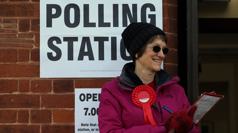 A Labour party Teller outside Trumpington village hall in Cambridgeshire, as voters cast their ballots in local council elections.