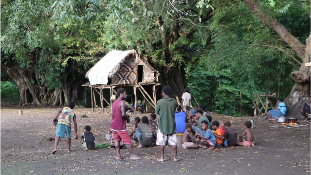 Prince Philip devotees gather after hearing about the duke's passing at age 99 yesterday, in Yaohnanen village, Tanna island, Vanuatu 10 April 2021