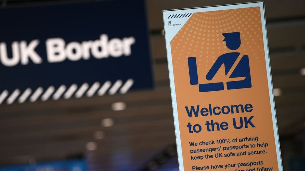UK border signage at passport control in Arrivals in Terminal 2 at Heathrow Airport