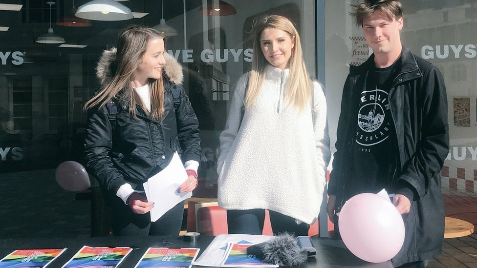 Brittany Pettibone (left), Lauren Southern (middle) and British activist Caolan Robertson (right), at a stall in Luton town centre