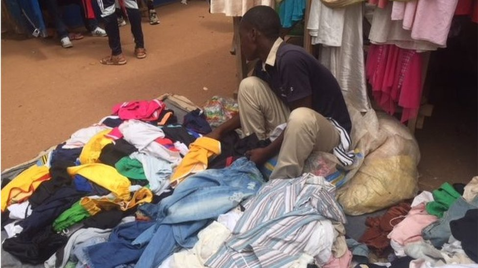 Man in a Kigali clothes market