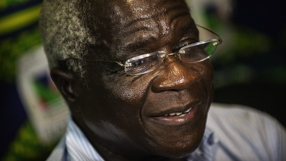 Afonso Dhlakama (C) speaks during an interview on October 11, 2014 in Maputo, Mozambique