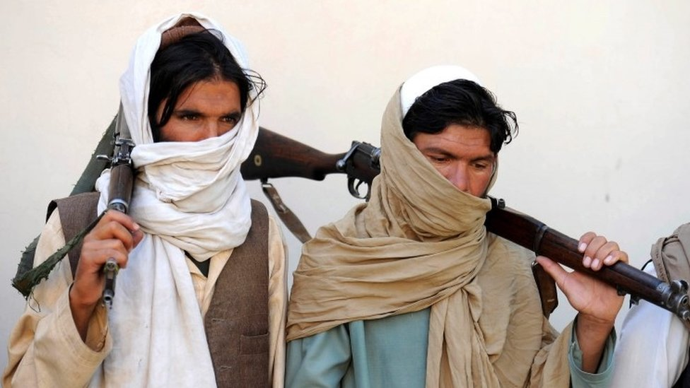 Alleged former Taliban fighters at a disarmament ceremony in Jalalabad, February 2016