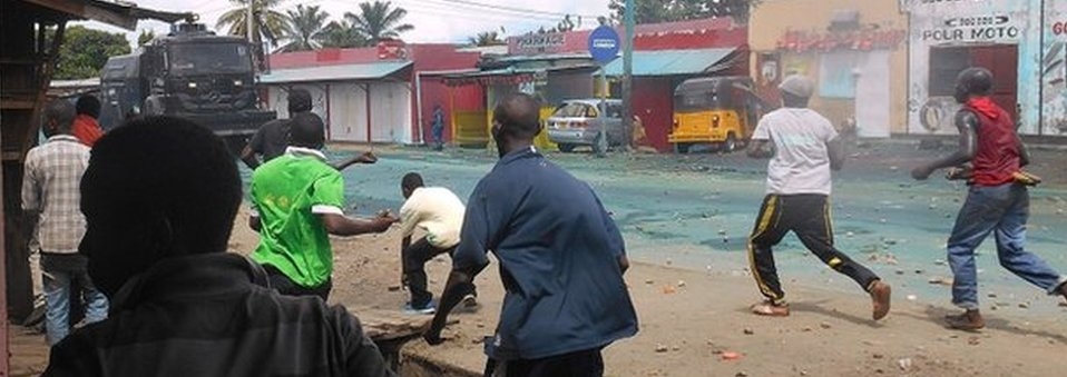 Protesters throw rocks during clashes with police in Cibitoke, north-western Burundi, on April 26, 2015