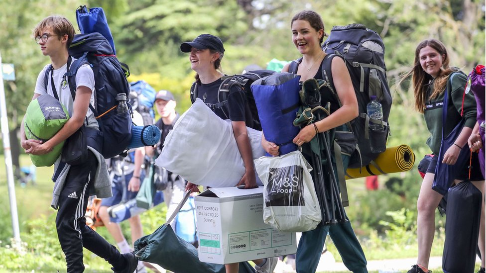 Festival goers arrive at Reading Festival