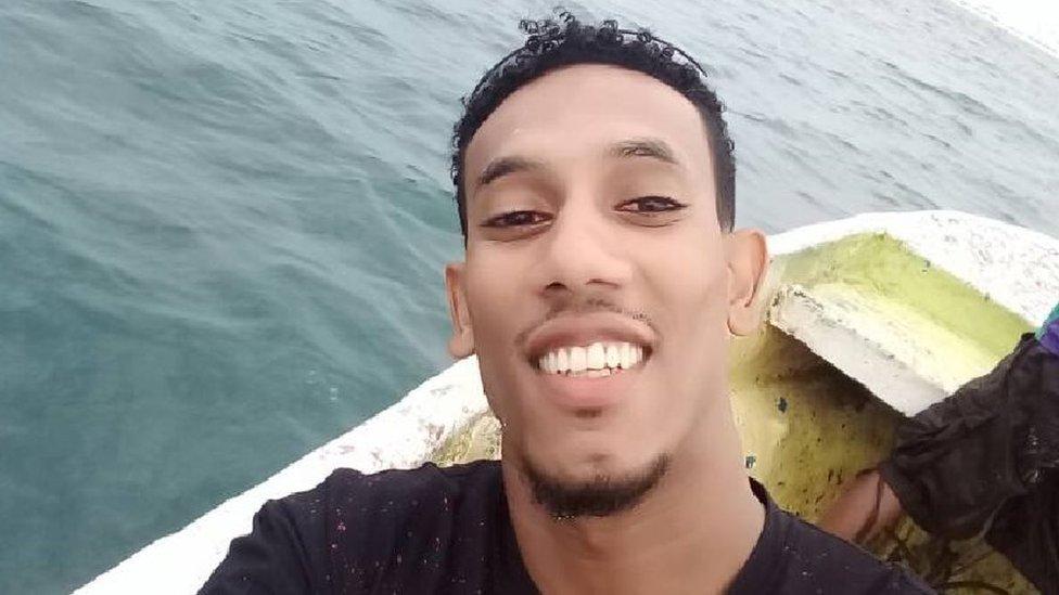 Anwar Mohamed takes a selfie in a boat