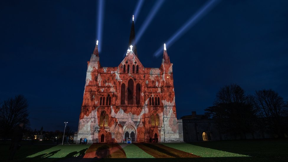 """The Royal British Legion""""s falling poppy display is projected onto the West Front of Salisbury Cathedral to commemorate the 100th anniversary of the armistice in Salisbury"""