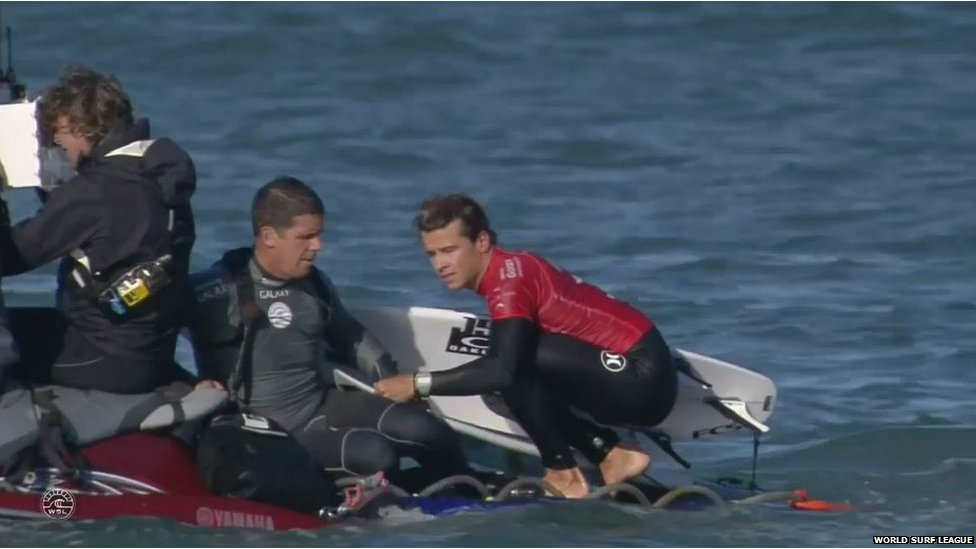 Julian Wilson being taken to safety
