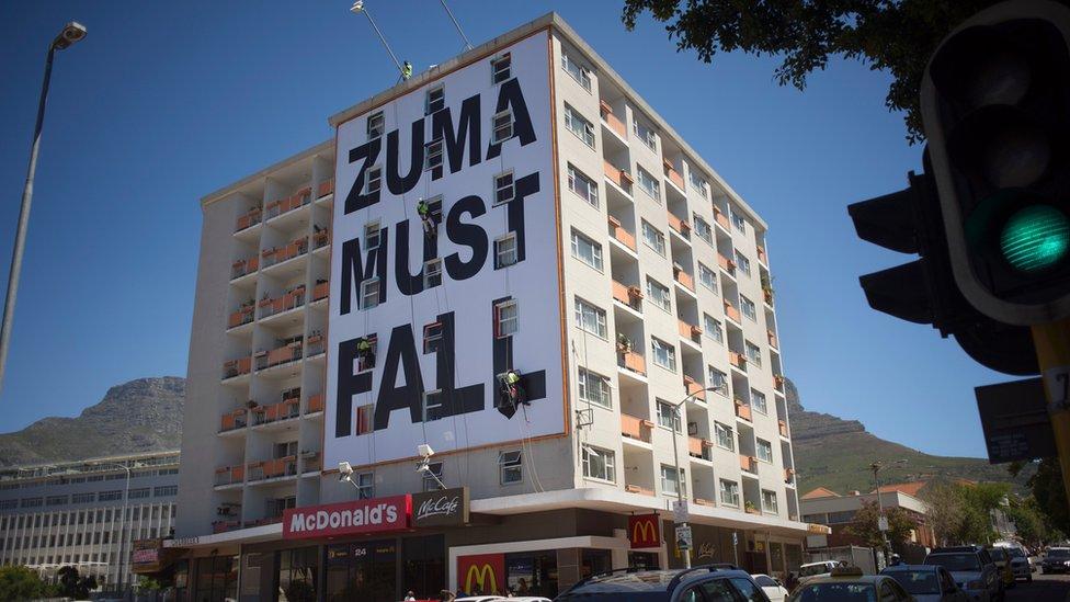 Zuma Must Fall banner hangs from building