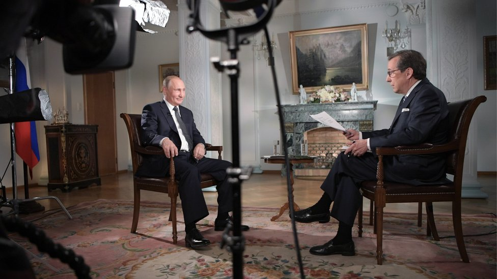 Russia's President Vladimir Putin gives an interview to Fox News Channel anchor Chris Wallace in 2018
